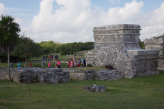 People visiting the Mayan ruins in Tulum Stock Photography