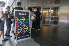 People visiting the Museum of Modern Art MoMA in New York City. New York, USA - May 26, 2018: People visiting the Museum of Modern Art MoMA in New York City. It royalty free stock photos