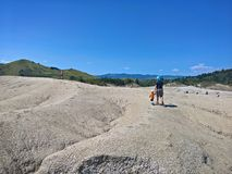 Father and child at Mud Volcanoes stock photography