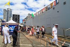 People visiting a New Zealand Navy warship at the Port of Auckland stock photo