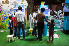 People visiting Nintendo stand at G! come giocare in Milan, Italy Royalty Free Stock Image