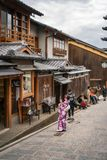 People visiting the old traditional streets of Gion District with shopping and old shrines. stock image