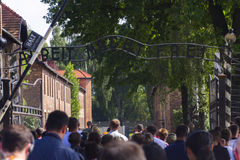 People visiting the Outdoors of Auschwitz I camp Stock Photography