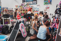 People visiting pet shop at Quattrozampeinfiera in Milan, Italy Stock Photography