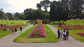 People visiting and relaxing inside beautiful Golden Gate Park filled with flowers and gardens