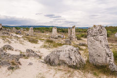 People visiting the Stone Forest, Bulgaria. People visiting the Stone Forest. Pobiti Kamani is an amazing natural rock formation located not far of Varna Royalty Free Stock Photography