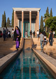 People Visiting Tomb of Saadi and Surrounding Persian Garden on a Sunny Day in Shiraz Royalty Free Stock Photo