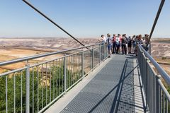 People visiting viewpoint with skywalk at Garzweiler brown-coal mine Germany Stock Image