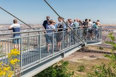 People visiting viewpoint with skywalk at Garzweiler brown-coal mine Germany Stock Photo