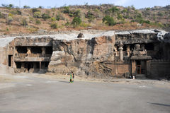 People visiting on walking the cave temple in Ellora Stock Photos