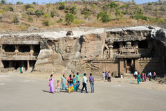 People visiting on walking the cave temple in Ellora Stock Image
