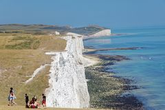 People visiting the white chalk cliffs in the Seven Sisters Coun Stock Photography