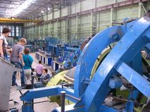 People visitors came to the factory to the workshop on a tour to see the industrial work at the aircraft factory in Novosibirsk 20. 11 stock photo