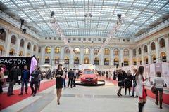 People and Volvo cars in Gostiny Dvor Stock Photo