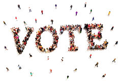 People that vote. Large group of people walking to and forming the shape of the word text vote on a white background Royalty Free Stock Images