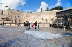 People at the Wailing Wall after the snowfall Stock Photos