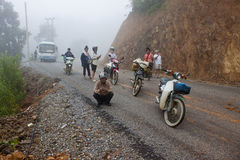 People wait for clearing a road after landslide Stock Photo