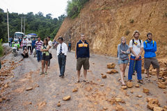 People wait for clearing a road after landslide. NORTHERN LAOS - AUGUST 14: People wait for clearing a road after landslide on August 14, 2012 in Northern Laos Royalty Free Stock Image