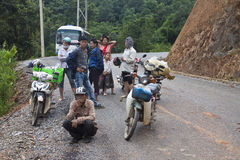 People wait for clearing a road. NORTHERN LAOS - AUGUST 14: People wait for clearing a road after landslide on August 14, 2012 in Northern Laos. Landslides are Royalty Free Stock Image