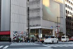 People wait at a crossing in front of iconic Sony Building in Ginza. View of the iconic Yoshinobu Ashihara-designed now-closed and marked for demolition Sony Stock Photos