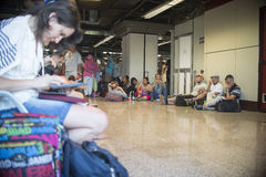People wait for delayed or cancelled flights Stock Photos