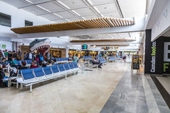 People wait in departure hall at Royalty Free Stock Image
