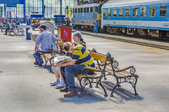 People wait in the famous West Train Station in Budapest Royalty Free Stock Image