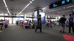 People wait flight at gate and walk inside of Don Mueang international airport stock footage