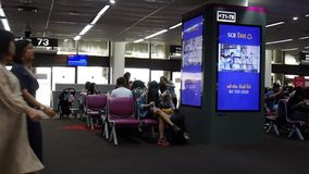 People wait flight at gate and walk inside of Don Mueang international airport. BANGKOK, THAILAND - JUNE 1 : Thai people and foreigner travelers waiting flight stock video footage
