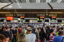 People wait in line to check their luggages stock images