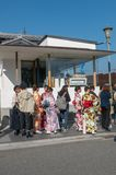 People wait in line to get coffee in Arashiyama, Japan. ARASHIYAMA, JAPAN-NOVEMBER 11, 2018 : People wait in line to get coffee in Arashiyama, Japan royalty free stock images