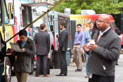 People Wait In Line To Order Meals From Food Trucks Royalty Free Stock Image