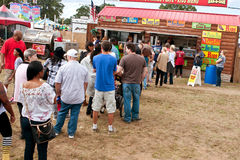 People Wait In Long Line To Buy Food At Fair. Hampton, GA, USA - September 27, 2014:  People wait in long line to order food from a concessions vendor at the Stock Images