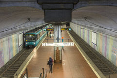 People wait at the metro station for the arriving train Stock Photography