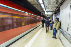 People wait at the metro station for the arriving train Stock Image