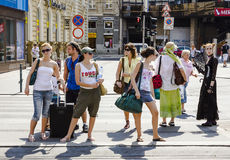 People wait at pedenstrian crossing in Budapest Stock Photo