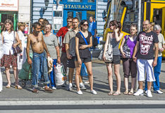 People wait at pedenstrian crossing in Budapest Royalty Free Stock Image