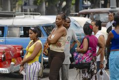 People wait in the queue for taxi in Havana, Cuba. Royalty Free Stock Image