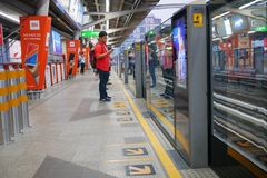 People wait for sky train at the station Bangkok,Thailand stock image