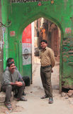 People wait something in one of yards nearly the. Delhi, India - February 20, 2015 people smile to someone in one of yards nearly the big bazaar in Delhi royalty free stock images