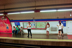 People wait at a subway  platform for their train. People wait at a subwy platform in downtown Madrid for their train Royalty Free Stock Photos