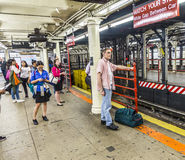 People wait at subway station times square in New York Stock Photos