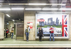 People wait in the subway station for the train Stock Image