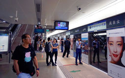People wait for a train at the MRT station Bugis in Singapore. Royalty Free Stock Photography