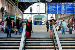 People wait for the trains on railway station Royalty Free Stock Images