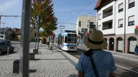 People wait tramway go to Heidelberg altstadt or old town at Sandhausen station. HEIDELBERG, GERMANY - AUGUST 25 : German and foreigner travelers people wait stock video