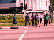 People waiting across the street. SINGAPORE-04 June, 2017:People waiting across the street Stock Image