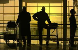 People waiting at the airport. Silhouette of people waiting at the airport Royalty Free Stock Images