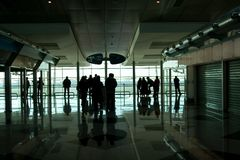 People waiting at the airport. People waiting at the international airport terminal stock images