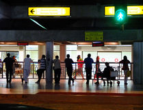 People waiting at airport Stock Images